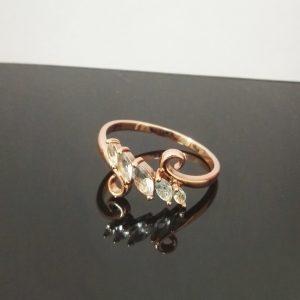 Дамски пръстен със кристалносини цирконии. Розово златно покритие